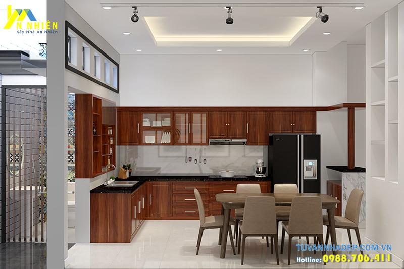 Phòng bếp được ngăn cách với các phòng công năng khách bằng lan gỗ
